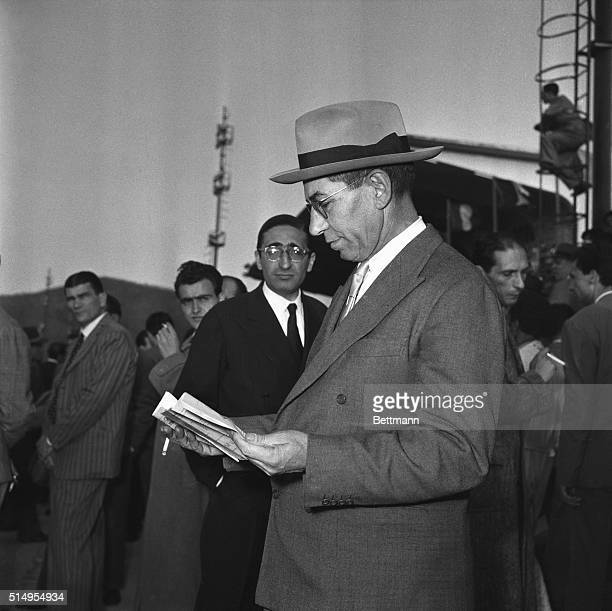 Charles Luciano peruses his scratch sheet or racing form prior to watching the Naples Agnano Grand Prix Trot race It has been reported that Luciano...