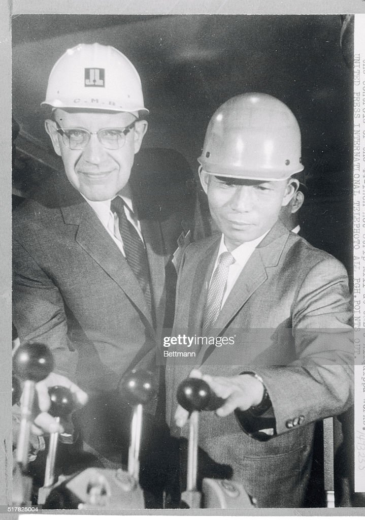 Charles M Beeghly Board Chairman of Jones and Laughlin Steel Corporation shows Chung Hee Park Pres of the Republic of Korea the controls of the...