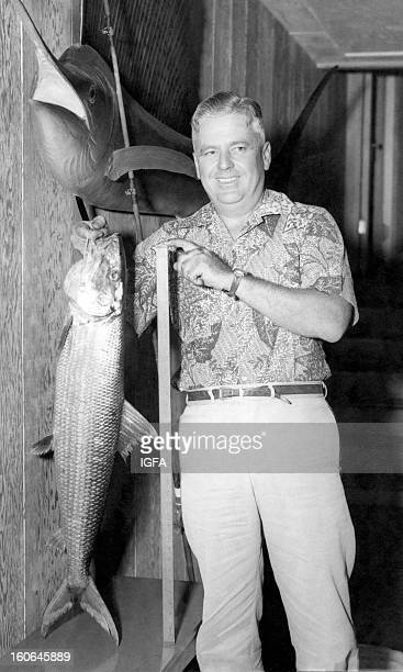 Charles M Cooke III holds a yardstick and his IGFA World Record 16 pound bonefish caught on 15 pound thread near West Molokai Hawaii on November 30...