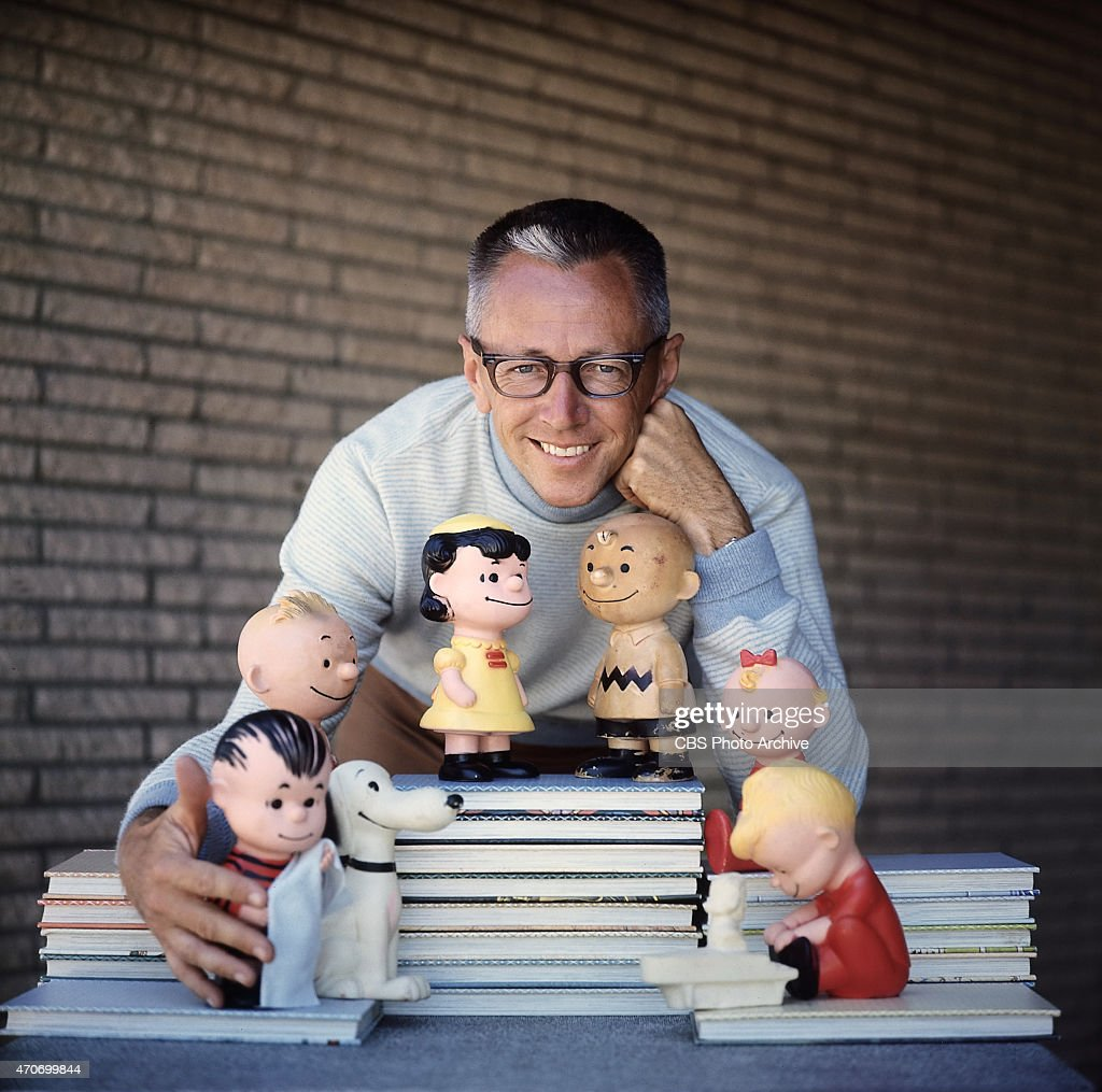 <a gi-track='captionPersonalityLinkClicked' href=/galleries/search?phrase=Charles+M.+Schulz&family=editorial&specificpeople=997865 ng-click='$event.stopPropagation()'>Charles M. Schulz</a> with a few of his Peanuts characters, including (on top of books) Lucy van Pelt and Charlie Brown, and below, from left, Linus (with blanket), Snoopy and Schroeder (at piano). Image dated January 1, 1962.