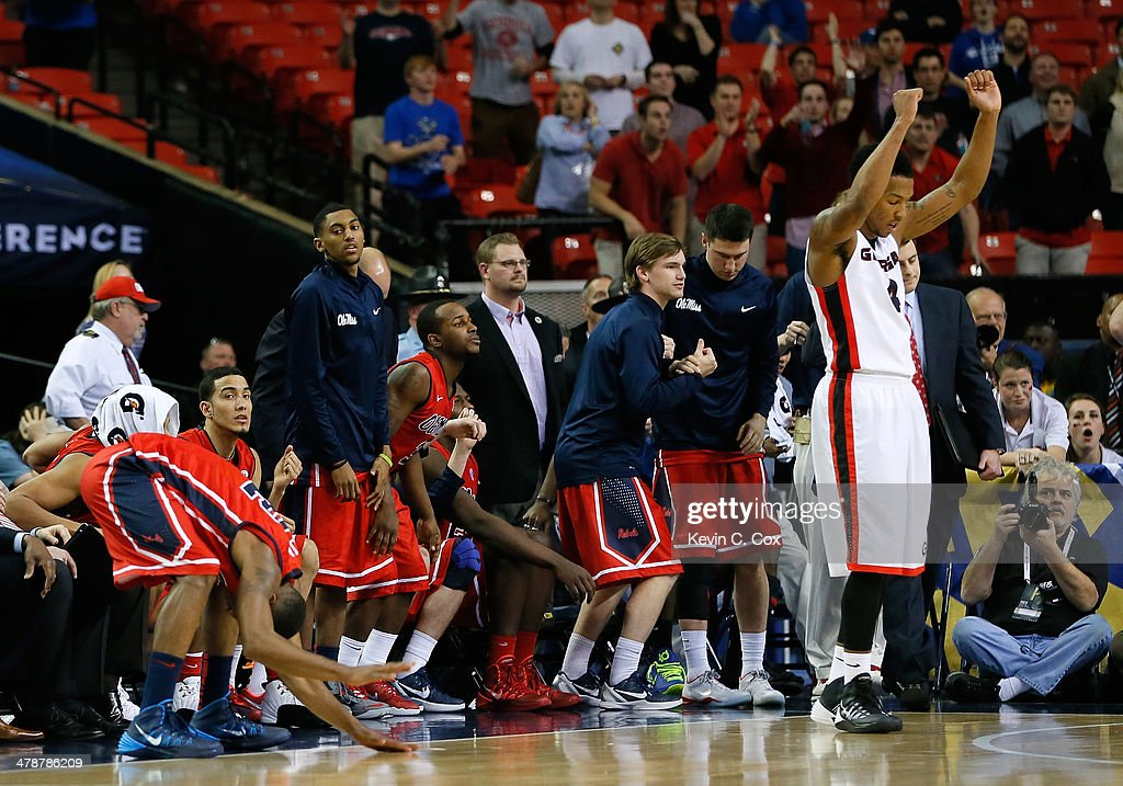 Charles Mann #4 of the Georgia Bulldogs celebrates their 75-73 win as Jarvis Summers #32 and the Mississippi Rebels bench react to a missed field goal by Summers as time expired during the quarterfinals of the SEC Men's Basketball Tournament at Georgia Dome on March 14, 2014 in Atlanta, Georgia.
