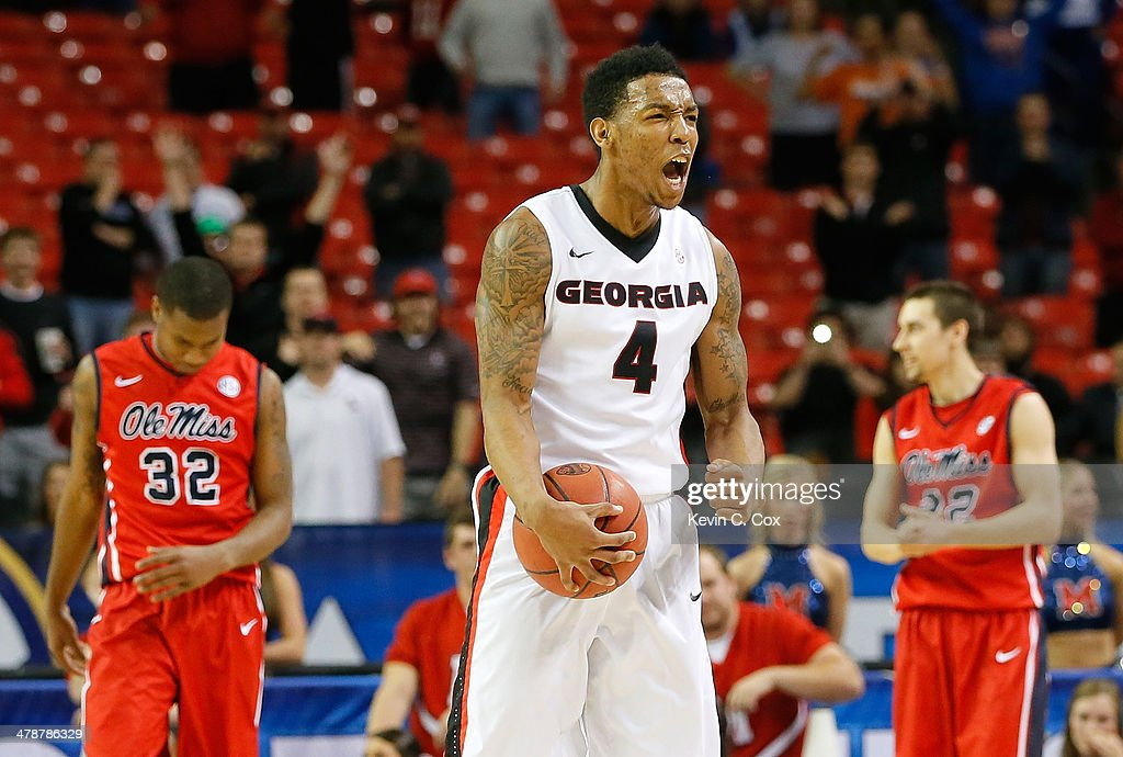 Charles Mann #4 of the Georgia Bulldogs reacts after forcing a turnover by the Mississippi Rebels during the quarterfinals of the SEC Men's Basketball Tournament at Georgia Dome on March 14, 2014 in Atlanta, Georgia.