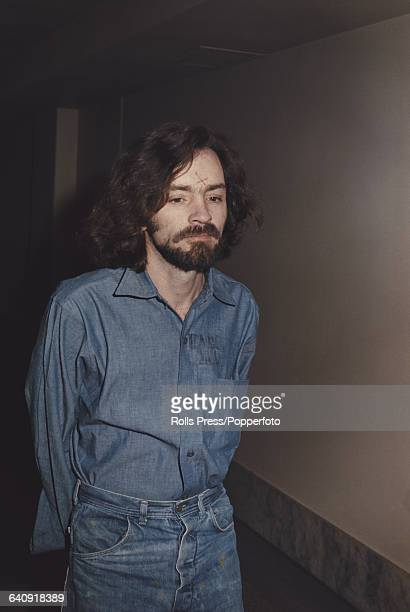Charles Manson main defendant in the Sharon Tate and LaBianca murder trial pictured wearing handcuffs on arrival in court in Los Angeles United...