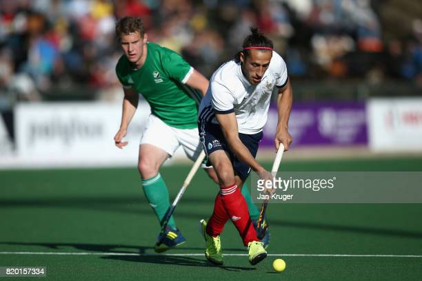 Charles Masson of France takes the ball away from Stephen Cole of Ireland during the 5th8th place play off match between Ireland and France on Day 7...