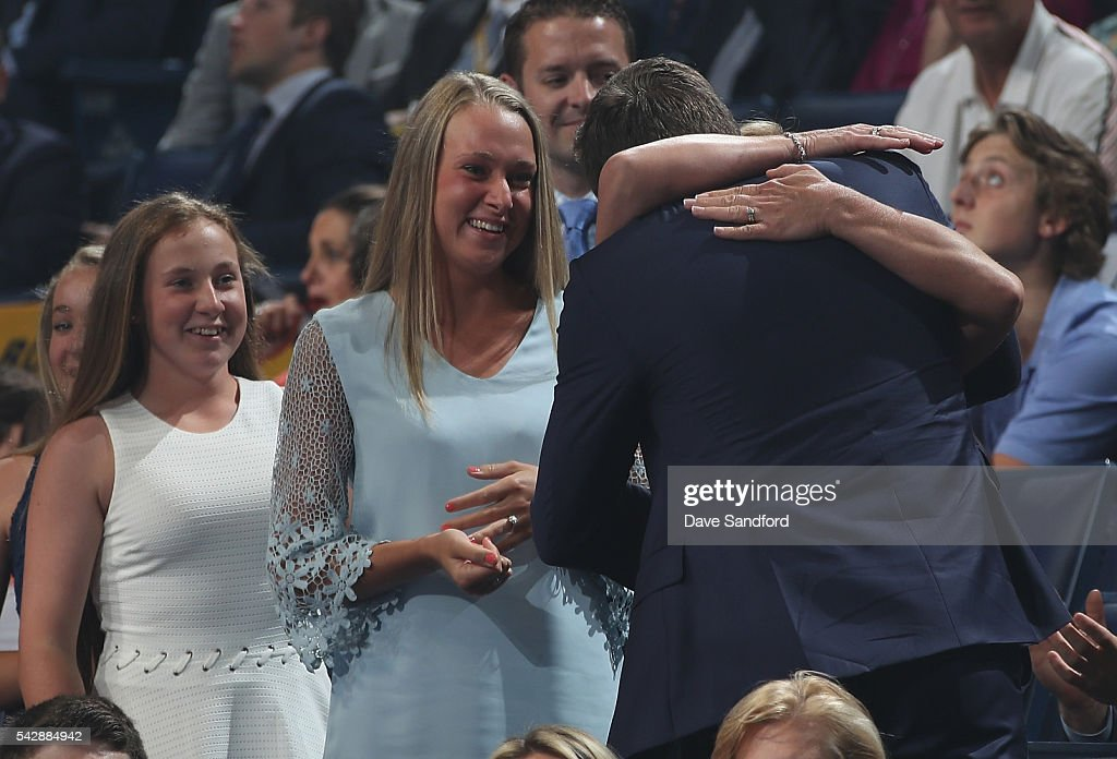 Charles McAvoy celebrates with his family after being selected 14th overall by the Boston Bruins during round one of the 2016 NHL Draft at First Niagara Center on June 24, 2016 in Buffalo, New York.