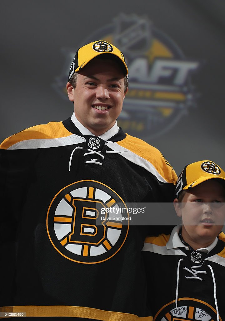 Charles McAvoy smiles onstage after being selected 14th overall by the Boston Bruins during round one of the 2016 NHL Draft at First Niagara Center on June 24, 2016 in Buffalo, New York.
