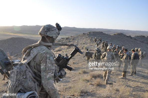 Charles McCullough from Brooklyn NY and other soldiers from the 2nd Battalion 504th Parachute Infantry Regiment 82nd Airborne Division walk back to a...