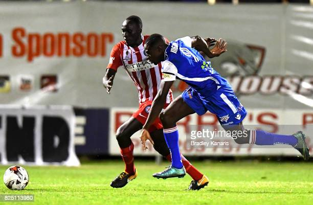 Charles Mendy of the Power and Bruce Kamau of Melbourne City challenge for the ball during the FFA Cup round of 32 match between the Peninsula Power...