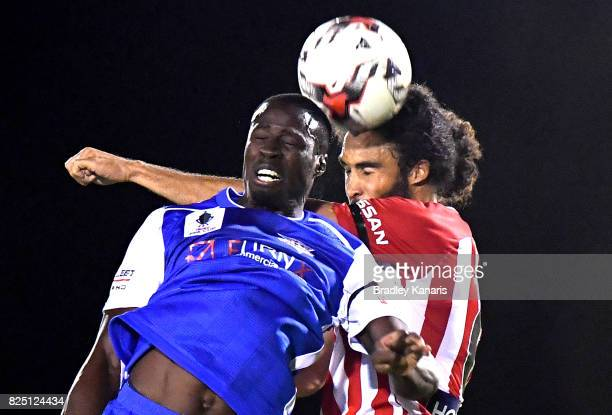 Charles Mendy of the Power and Osama Malik of Melbourne City challenge for the ball during the FFA Cup round of 32 match between the Peninsula Power...