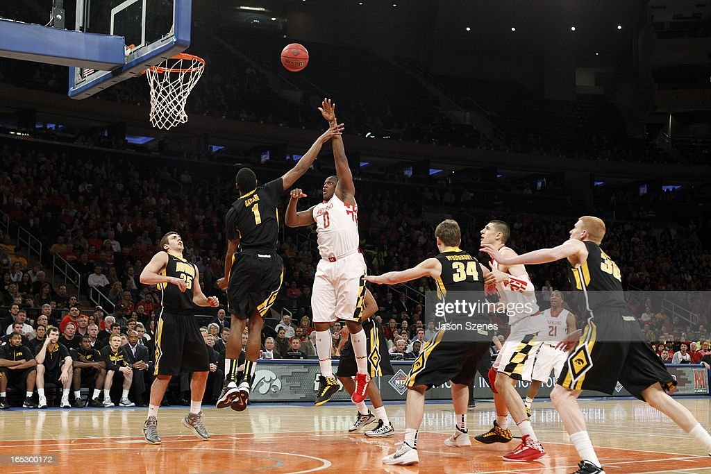 Charles Mitchell #0 of the Maryland Terapins puts up a shot past Melsahn Basabe #1 of the Iowa Hawkeyes in the first half during the 2013 NIT Championship - Semifinals at the Madison Square Garden on April 2, 2013 in New York City.