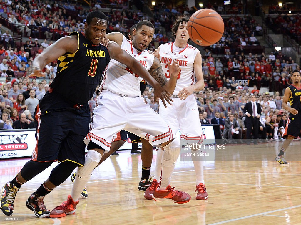 Charles Mitchell #0 of the Maryland Terrapins and Amir Williams #23 of the Ohio State Buckeyes battle for control of a loose ball in the first half on December 4, 2013 at Value City Arena in Columbus, Ohio. Ohio State defeated Maryland 76-60.