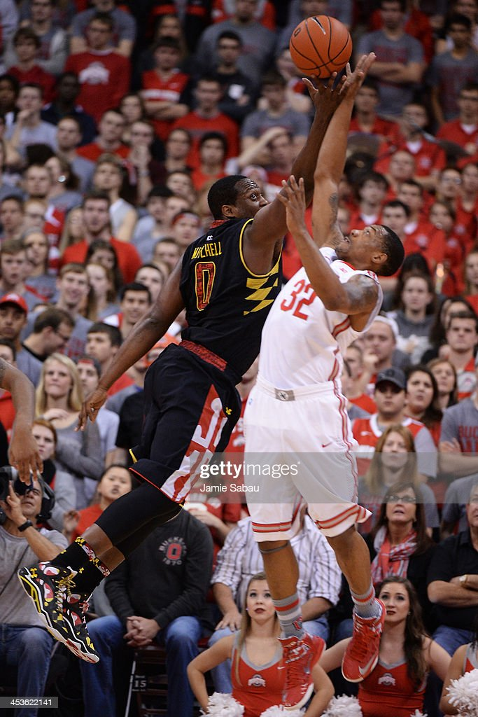 Charles Mitchell #0 of the Maryland Terrapins and Lenzelle Smith, Jr. #32 of the Ohio State Buckeyes battle for control of a rebound in the second half on December 4, 2013 at Value City Arena in Columbus, Ohio. Ohio State defeated Maryland 76-60.
