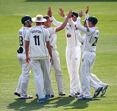Charles Morris of Worcestershire celebrates with team mates after taking the wicket of Gregory Smith of Essex during day one of the LV County...