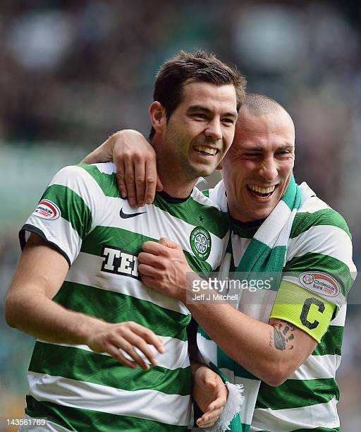 Charles Mulgrew and Scott Brown of Celtic celebrate following the Clydesdale Bank Premier League match between Celtic and Rangers at Celtic Park on...