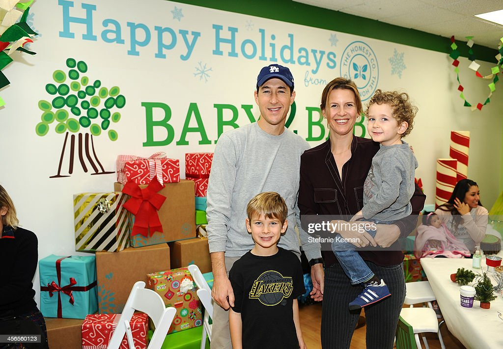 Charles Nelson and Candace Nelson and sons Charlie (front, standing) and Harry attend the Third Annual Baby2Baby Holiday Party presented by The Honest Company on December 14, 2013 in Los Angeles, California.