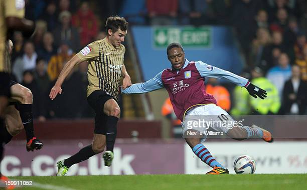 Charles N'Zogbia of Aston Villa challenged by Carl McHugh of Bradford City during the Capital One Cup SemiFinal match Second Leg between Aston Villa...