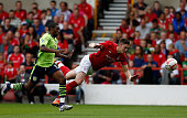 Charles N'Zogbia of Aston Villa in action with Greg Halford of Nottingham Forest during the preseason friendly match between Nottingham Forest and...
