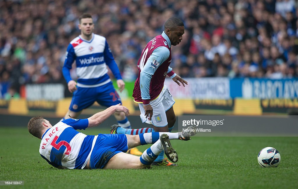 Charles N'Zogbia of Aston Villa is challenged by Alex Pearce of Reading during the Barclays Premier League match between Reading and Aston Villa at Madejski Stadium on March 09, 2013 in Reading, England.