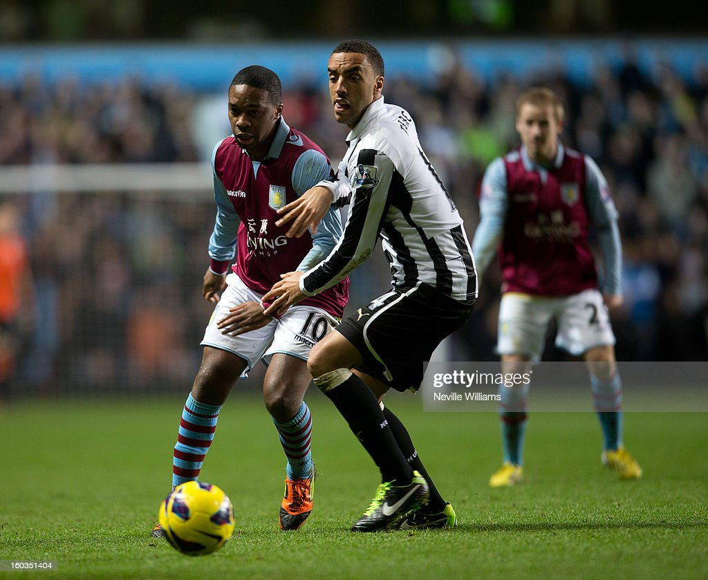 Charles N'Zogbia of Aston Villa is challenged by James Perch of Newcastle United during the Barclays Premier League match between Aston Villa and Newcastle United at Villa Park on January 29, 2013 in Birmingham, England.