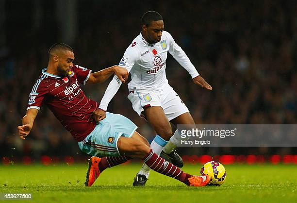 Charles N'Zogbia of Aston Villa is tackled by Winston Reid of West Ham United during the Barclays Premier League match between West Ham United and...