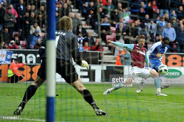 Charles N'Zogbia of Wigan Athletic scores his team's third goal during the Barclays Premier League match between Wigan Athletic and West Ham United...