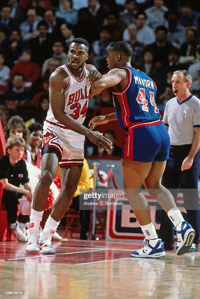 Charles Oakley of the Chicago Bulls defends against Rick Mahorn of the Detroit Pistons circa 1987 at Chicago Stadium in Chicago Illinois NOTE TO USER...