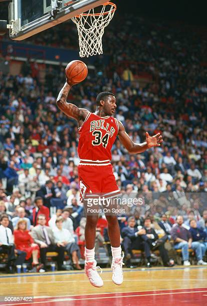 Charles Oakley of the Chicago Bulls grabs a rebound against the Washington Bullets during an NBA basketball game circa 1987 at the Capital Centre in...