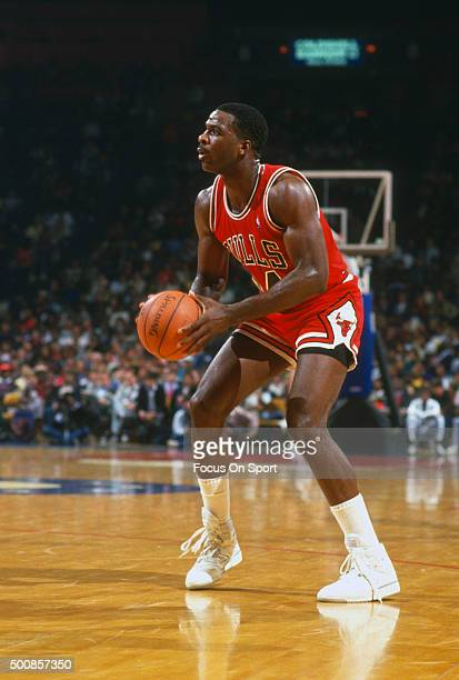Charles Oakley of the Chicago Bulls looks to shoot against the Washington Bullets during an NBA basketball game circa 1986 at the Capital Centre in...