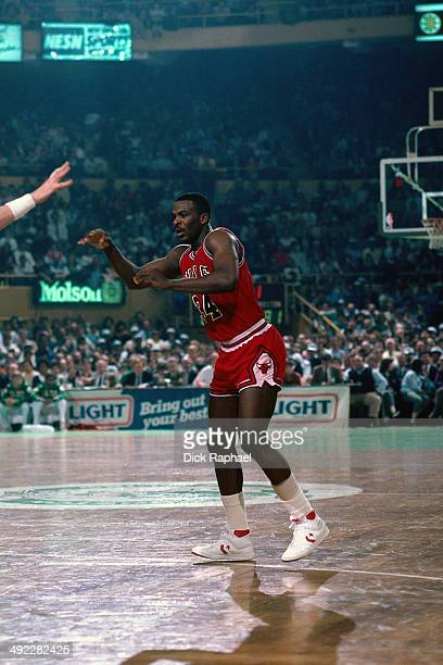 Charles Oakley of the Chicago Bulls passes the ball against the Boston Celtics during a game circa 1986 at the Boston Garden in Boston Massachusetts...