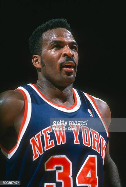 Charles Oakley of the New York Knicks looks on against the Washington Bullets during an NBA basketball game circa 1995 at the US Airways Arena in...
