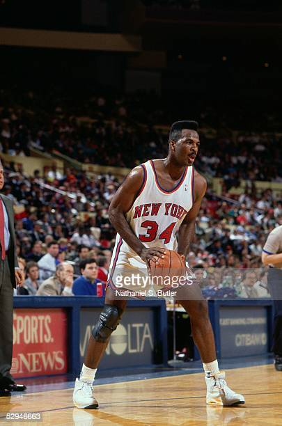 Charles Oakley of the New York Knicks looks to make a play during an NBA game at Madison Square Garden circa 1990 in New York New York NOTE TO USER...