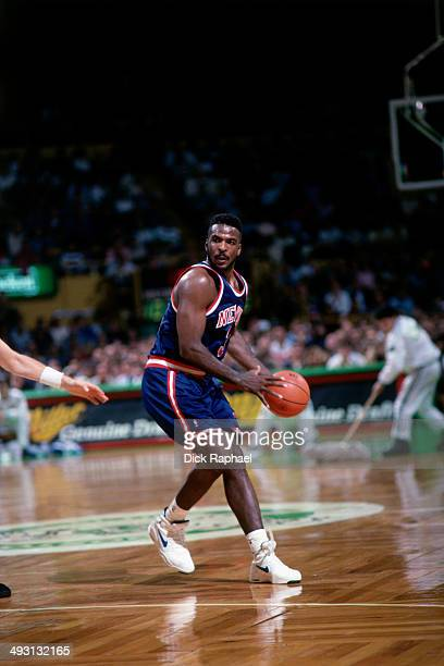 Charles Oakley of the New York Knicks looks to pass against the Boston Celtics during a game played circa 1994 at the Boston Garden in Boston...