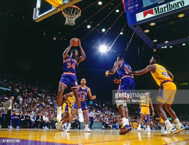 Charles Oakley of the New York Knicks rebounds against the Los Angeles Lakers at the Great Western Forum in Inglewood California circa 1991 NOTE TO...