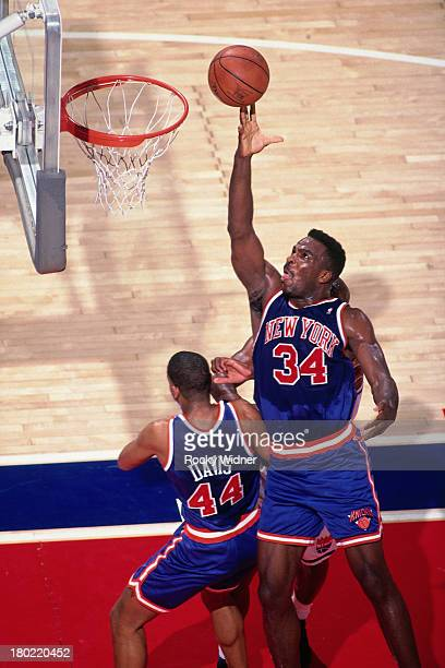 Charles Oakley of the New York Knicks shoots the ball against the Sacramento Kings on March 1 1994 at Arco Arena in Sacramento California NOTE TO...