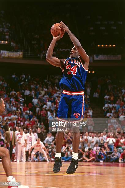 Charles Oakley of the New York Knicks shoots the ball during Game Two of the NBA Finals against the Houston Rockets on June 10 1994 at The Summit in...