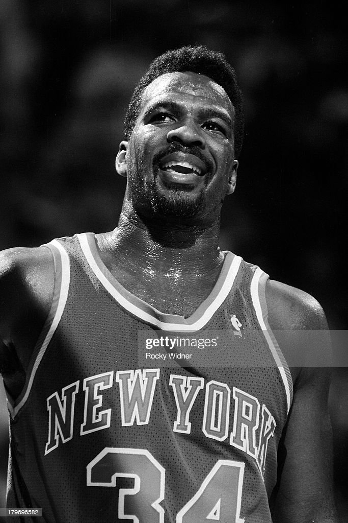 <a gi-track='captionPersonalityLinkClicked' href=/galleries/search?phrase=Charles+Oakley&family=editorial&specificpeople=213241 ng-click='$event.stopPropagation()'>Charles Oakley</a> #34 of the New York Knicks smiles against the Sacramento Kings on November 10, 1990 at Arco Arena in Sacramento, California.