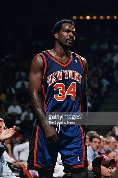 Charles Oakley of the New York Knicks walks across the court during the game against the Houston Rockets on November 18 1997 at the Compaq Center in...