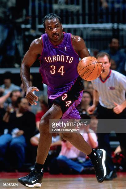 Charles Oakley of the Toronto Raptors dribbles against the Cleveland Cavaliers during a game played in 2000 at the Air Canada Centre in Toronto...