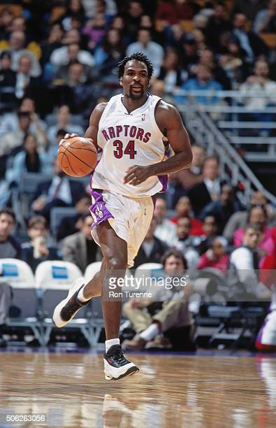 Charles Oakley of the Toronto Raptors drives against the New Jersey Nets on December 21 1999 at the Air Canada Centre in Toronto Ontario in Canada...