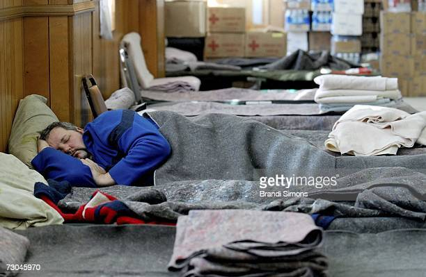 Charles Odom sleeps on a cot at an American Red Cross emergency shelter on January 19 2007 in Pryor Oklahoma Some residents of Pryor and other...