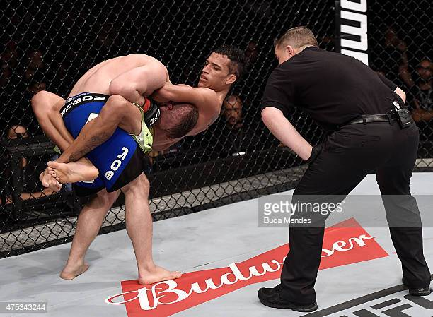 Charles Oliveira attempts to submit Nick Lentz of the United States in their featherweight UFC bout during the UFC Fight Night event at Arena Goiania...