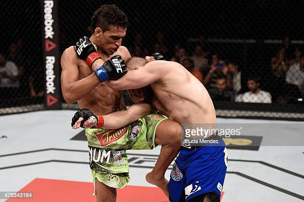Charles Oliveira kicks Nick Lentz of the United States in their featherweight UFC bout during the UFC Fight Night event at Arena Goiania on May 30...