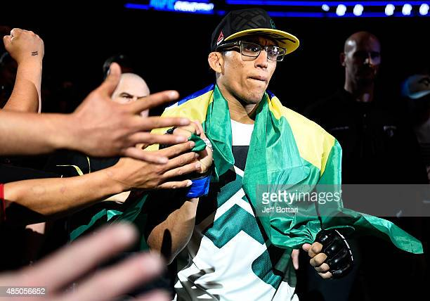 Charles Oliveira of Brazil enters the arena before his featherweight bout against Max Holloway during the UFC event at the SaskTel Centre on August...