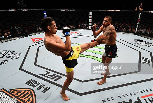 Charles Oliveira of Brazil kicks facing Anthony Pettis of the United States in their featherweight bout during the UFC Fight Night event at Rogers...