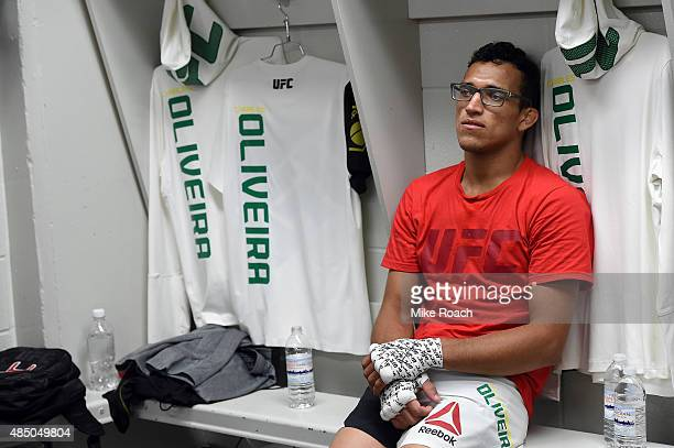Charles Oliveira of Brazil relaxes in his locker room before his bout against Max Holloway during the UFC event at the SaskTel Centre on August 23...