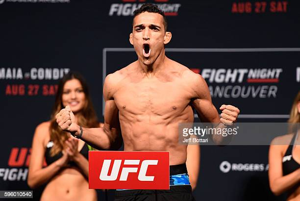 Charles Oliveira of Brazil steps on the scale during the UFC Fight Night Weighin at Rogers Arena on August 26 2016 in Vancouver British Columbia...