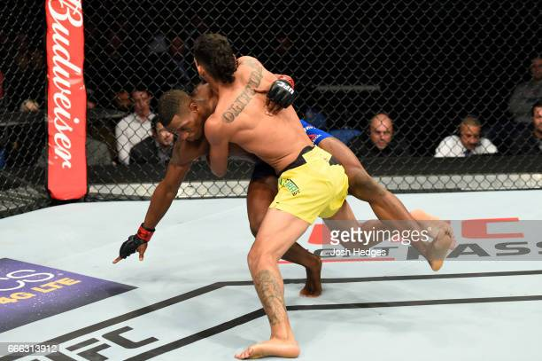 Charles Oliveira of Brazil takes down Will Brooks in their lightweight bout during the UFC 210 event at KeyBank Center on April 8 2017 in Buffalo New...