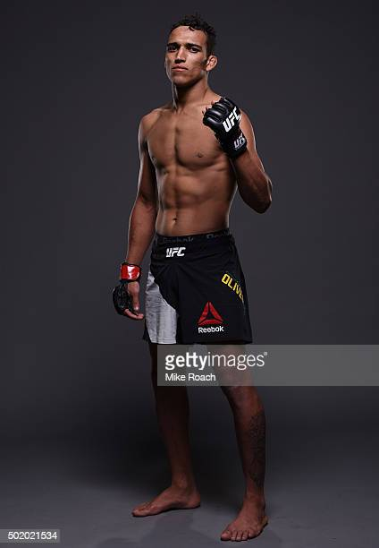 Charles Oliveira poses for a post fight portrait backstage during the UFC Fight Night event at the Amway Center on December 19 2015 in Orlando Florida