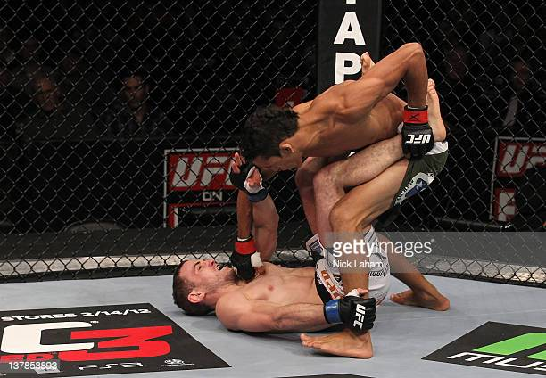 Charles Oliveira punches Eric Wisely during the UFC on FOX event at United Center on January 28 2012 in Chicago Illinois