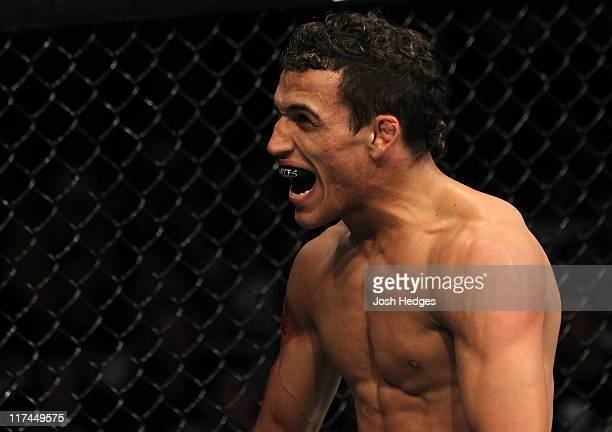 Charles Oliveira reacts after defeating Nik Lentz by submission during a Lightweight contest at the UFC on Versus 4 event at the CONSOL Energy Center...